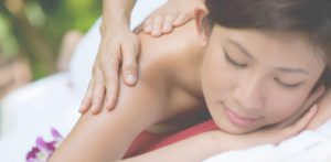 Woman relaxes with a professional massage